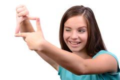 bakgrundsflicka över white för forstudiotonåring Arkivbild