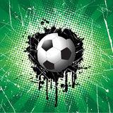 bakgrundsfotbollgrunge Arkivbild