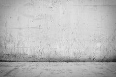 Bakgrundsinre: betongvägg och golv Arkivbild