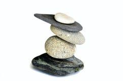 bakgrundsjämvikt balanserade färgade close upp fyra stenar för greypebblesten Royaltyfria Foton