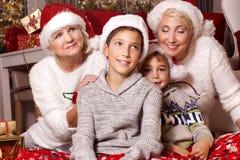 bakgrundsjulen stänger upp röd tid lycklig familj Arkivfoton