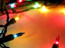 bakgrundsjullampor Fotografering för Bildbyråer
