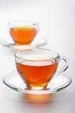 bakgrundskoppar över white för tea två arkivbild