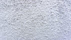 Bakgrundslutningen texturerade den dirtty väggen för gammal cementgrunge arkivfoto