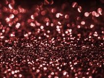 Bakgrundspaljett röd sparkle blänka surfactanten Ferieabstrakt begrepp blänker bakgrund med blinkaljus Tygpaljetter i b royaltyfri bild