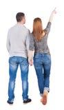 bakgrundspar som isoleras över att peka bakre sikt, wall vitt barn Tillbaka sikt (kvinnan och mannen) Arkivbilder