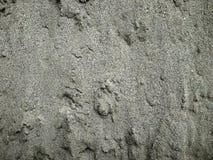 Bakgrundssamling - ett tjockt lager av cement på jordningen arkivbild