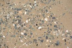 Bakgrundssand- och havskiselstenarna Fotografering för Bildbyråer