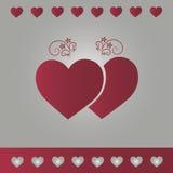 Bakgrundssilver med röda hjärtor Arkivfoton