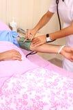bakgrundssjuksköterska Fotografering för Bildbyråer
