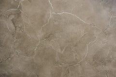 Bakgrundstextur av beigea guld- murbrukväggar Royaltyfri Fotografi