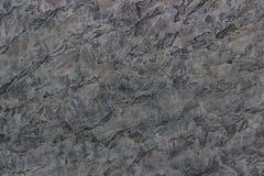 Bakgrundstextur av dekorativa murbrukskuggor av grå färger arkivfoton