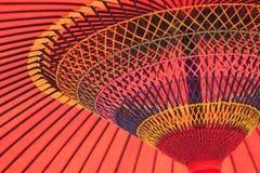 Bakgrundstextur av den japanska röda slags solskydd Arkivfoton