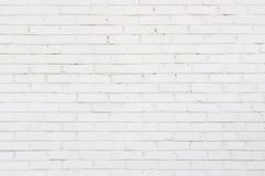 Bakgrundstextur av en gammal vit tegelstenvägg arkivfoto