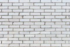 Bakgrundstextur av en gammal vit tegelstenvägg Royaltyfri Fotografi