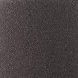Bakgrundstextur av ett skinande metallark med en punkterad buse texturerade reflekterande ljus för yttersida rostigt och glas- Arkivfoton