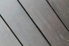 Bakgrundstextur av träpryda med parallella plankor med mellanrum Royaltyfria Bilder