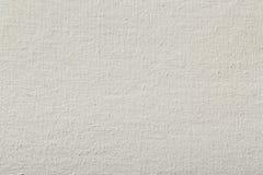 Bakgrundstextur av vitt bomullstyg med rullar Royaltyfri Bild