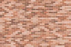 Bakgrundstextur med den bruna tegelstenväggen Arkivfoto