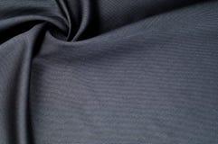 Bakgrundstextur, modell grå färger för torkdukeulldräkt En äkta fla royaltyfri fotografi