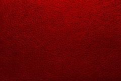Bakgrundstextur skvalpade yttersida under röd färg för hud Royaltyfria Foton