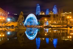 The Bakhram-Gur memorial fountain and Flame towers in a night landscape, Baku. BAKU, AZERBAIJAN - DECEMBER 29, 2017: The Bakhram-Gur memorial fountain and Flame Royalty Free Stock Photo