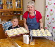 Baking. Mother and daughter baking together Stock Photos