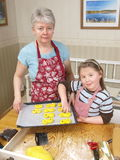 Baking. Mother and daughter baking together Royalty Free Stock Image