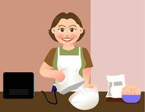 Baking. A lovely mother is baking in kitchen Stock Photo