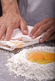 Baking. Pastry chef preparing dough for baking Royalty Free Stock Photo