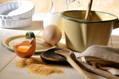 Baking. Retro kitchen equipment and baking ingredients on a kitchen table Stock Image