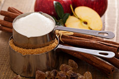 Baking with apple, sugar and cinnamon stock photography