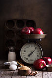 Baking with apples ingredients on rustic table Royalty Free Stock Photography
