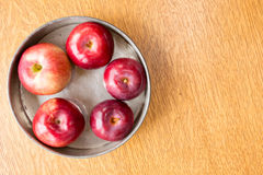 Baking apples in a pie tin. Ripe red fresh raw apples arranged in a vintage metal pie tin Royalty Free Stock Image