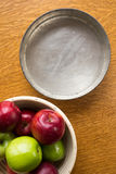 Baking apples and pie tin. Vintage pie tin and basket of baking apples Royalty Free Stock Photography