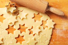 Baking. Arrangement of pastry, rolling pin, and cookie cutters royalty free stock photo