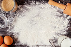 Baking background. Baking ingredients on the wooden table. Baking background. Baking ingredients with copy space on the wooden dark table Royalty Free Stock Images