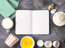 Baking background with blank book, eggs, flour, milk. Free space Royalty Free Stock Image