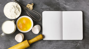 Baking background with blank book, eggs, flour, milk. Free space Royalty Free Stock Photo
