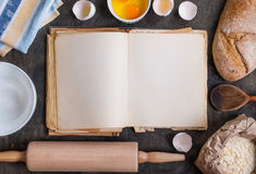 Baking background with blank cook book, flour, rolling pin Stock Photos