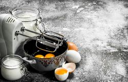 Baking background. Blend eggs with a mixer to make a dough. stock image