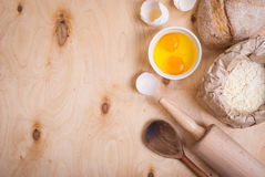 Baking background with bread, eggshell, flour, rolling pin. Clos Stock Photography