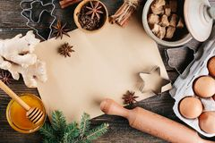 Baking background for Christmas cookies. Recipe paper in the center. Wooden background. Top view Royalty Free Stock Image