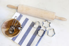 Baking background with cookie cutters and measuring spoons Stock Photography