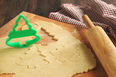 Baking background with dough and cookie cutters. Baking background with dough and christmas cookie cutters Stock Photo
