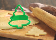 Baking background with dough and cookie cutters. Christmas baking background with dough and cookie cutters Royalty Free Stock Photo