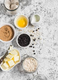 Baking background. Flour, sugar, butter, rolled oats, eggs, chocolate chips on a light background. Royalty Free Stock Photos