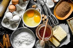 Baking background. Flour and various ingredients for dough royalty free stock photography