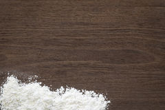 Baking background, flour on vintage wood table Stock Images