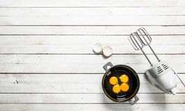 Baking background. Fresh eggs with a mixer. royalty free stock photo